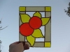 Orange and yellow flowers stained glass