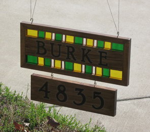 Wood and Stained Glass sign with light shining through